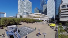 People walk near Residence Lorraine in business centre La Defense - stock footage