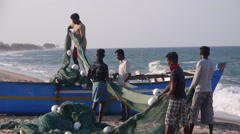 Fisherman loading net beach,Batticaloa,Sri Lanka Stock Footage