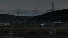 Stock Video Footage of Eastern Europe industrial landscape Jucu Romania  power lines storm passing time