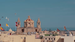150fps - Maltese Flags And Church in Slow Motion With Birds Stock Footage