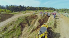 Man ties up rope to loader for pull off-road vehicle Stock Footage