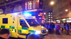 A yellow rescue ambulance moving fast in the streets Stock Footage