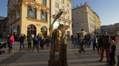 Man costumed in angel in Old Town Square in Krakow Stock Footage