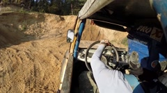 Sportsmen rides in off-road vehicle by dirt road in forest Stock Footage