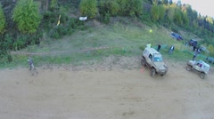 Truck rides by sand track during Rainforest Challenge Stock Footage