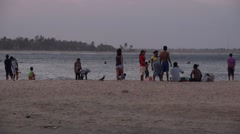 People at beach in evening,Arugam Bay,Sri Lanka Stock Footage
