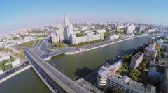 Cityscape with car traffic on Bolshoy Ustyinsky bridge Stock Footage