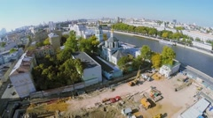 Building site near Church of St. Nicholas and traffic on quay Stock Footage