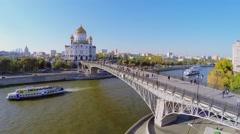Several touristic vessels sail near Patriarshiy bridge Stock Footage