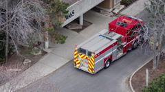 Fire Engine P101 is seen in front of a apartment building Stock Footage