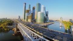 Transport ride by Dorogomilovskiy bridge near skyscraper complex Stock Footage