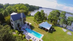 People get rest near country house on shore of Chesapeake Bay Stock Footage