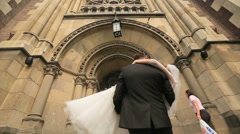Happy young   bride and groom turns and kisses Stock Footage