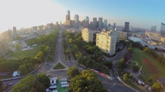 Cityscape with street traffic at autumn evening. Aerial view - stock footage