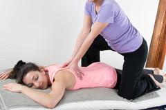 Beautiful woman enjoying massage and body treatment isolated on white Stock Photos