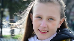 Blue eyed blonde girl smiling street, facial expression, portrait, slow motion - stock footage