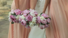 peony bouquets bride and bridesmaids - stock footage
