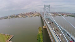 Train ride by Benjamin Franklin Bridge with traffic at autumn Stock Footage