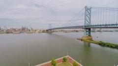 Benjamin Franklin Bridge over Delaware river at autumn - stock footage