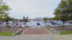 Boats and yachts are on moorage in Wiggins Park and Marina Stock Footage
