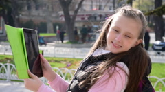 Beautiful tourist teenage girl taking picture, selfie with tablet Stock Footage