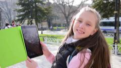 Beautiful tourist teenage girl taking picture, selfie with tablet, slow motion Stock Footage