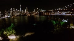 Riverscape with illuminated Brooklyn Bridge and skyscrapers Stock Footage