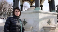 German fountain, Sultanahmet, Istanbul, tourist woman looking, tilt shot Stock Footage