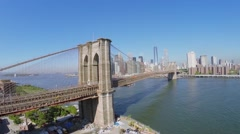 Cityscape with traffic on Brooklyn Bridge and Manhattan Bridge - stock footage
