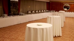 Round tables covered with tablecloths in the hall Stock Footage