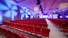 Rows of red chairs in a modern spacious conference hall Stock Footage