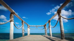 Wooden bridge on the beach near the ocean timelapse - stock footage