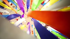 Many multi-colored ribbons are fixed on a metal grid Stock Footage