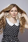 Young long-haired curly blonde woman - stock photo