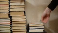 A stack of old books. Cleaning bulkhead home Stock Footage