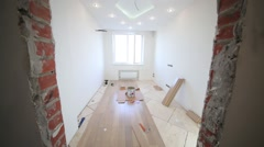 Bright room in the process of parquet installation Stock Footage