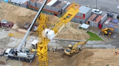 Building cranes and other building machinery at construction site Stock Footage