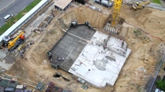 Construction site with the foundation and construction equipment Stock Footage