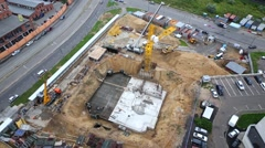 Foundation of building under construction and tower crane Stock Footage
