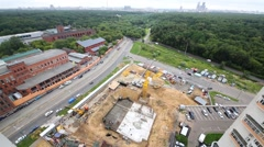 Urban landscape with a construction site and the park in summer Stock Footage