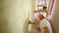Two professional builders making finish in the apartment. Stock Footage