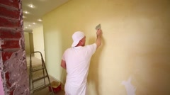 Plasterer making furnish the apartment with help of pallet. - stock footage