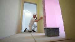 Builder is polishing corner of room using the sanding sponge. Stock Footage