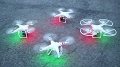 Four quadrocopters with rotating speeding-up propellers Stock Footage