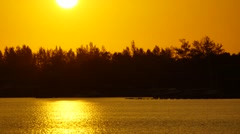 Golden sunset at Sabah Borneo with boat passing. Stock Footage