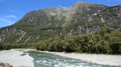 New Zealand Fiordland Cleddau River rapids below mountain face Stock Footage