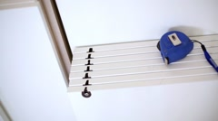 Stack of shelves for sliding door wardrobe with tape-measure Stock Footage