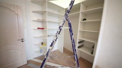 Room with stepladder and slide wardrobe under assembling. Stock Footage