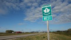 Trans Canada Highway 1 sign in Saskatchewan, Canada. Red truck passes. - stock footage