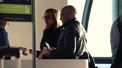Couple at boarding gate Stock Footage